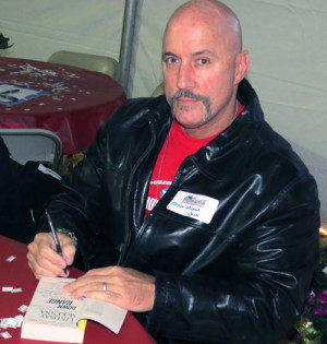 Chief Jaco autographing a copy of Down Range